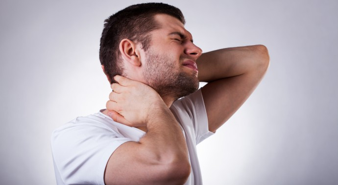 man with neck pain that can be treated by our chiropractor in West haven